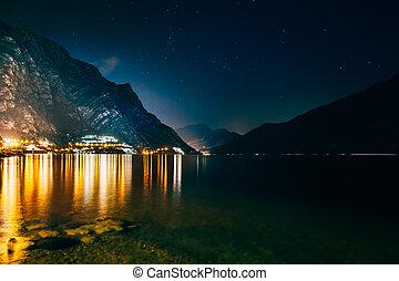 Scenic night view of illuminated town Limone sul Garda,...