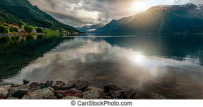 Scenic Norwegian Fjord And Surrounding Mountains