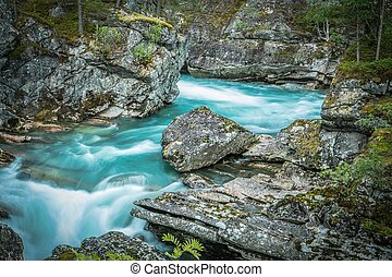 Scenic Norwegian Glacial River Inside Rocky Canyon.