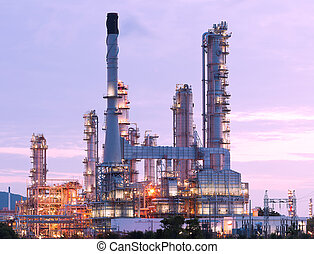 scenic of petrochemical oil refinery plant shines at night,...
