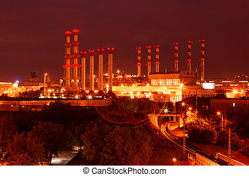 scenic of petrochemical oil refinery plant shines at night.