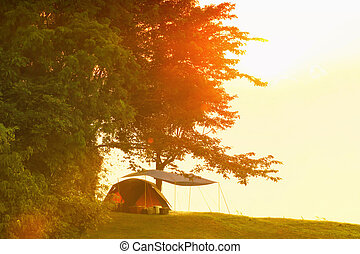 Scenic of sunset behind the tent.