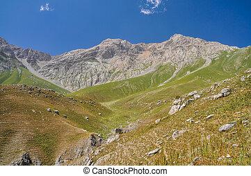 Kyrgyzstan - Scenic peaks in mountain range Tien-Shan in ...