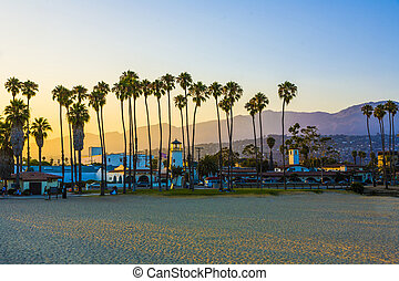scenic promenade with lighthouse and palms in Santa Barbara ...