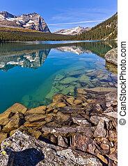 Scenic Reflections on Lake Ohara, Near Banff, Canada