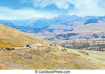 Scenic Road Along Mountain Ranges in Yellowstone National Park