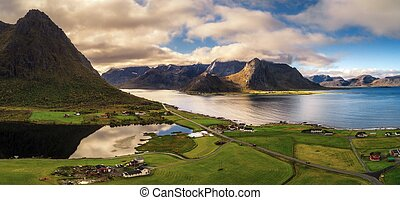 Scenic road along the coastline and mountains on Lofoten islands