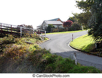 scenic road leading to a house