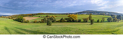 scenic rural landscape with fields,forest and green meadows in the Taunus area in Germany
