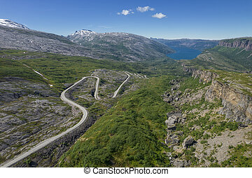 Scenic Nordland County, Norway. Saltfjellet Svartisen National Park Summer Aerial Scenery. Road to the Fjord.