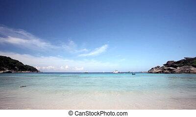 Scenic sand beach under bright blue sky, Similian Islands, Thailand