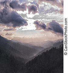 silhouette image of mountains and clouds