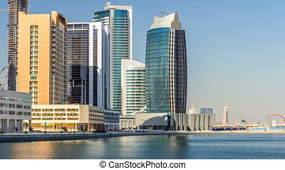 Scenic skyline of Dubai's business bay with skyscrapers at day time timelapse.