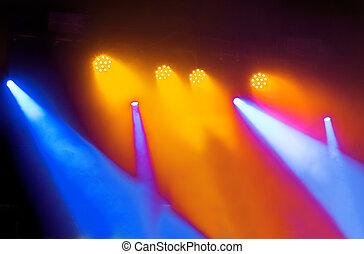 spotlights against dark background