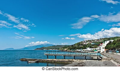 Scenic summer panorama of Black Sea pier .
