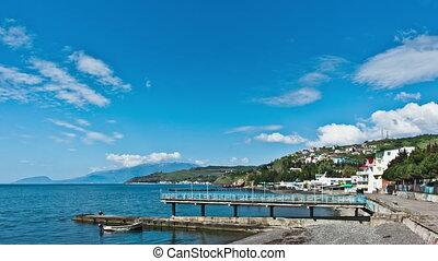 Scenic summer panorama of Black Sea pier .Crimea