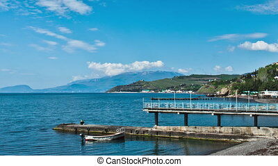 Scenic summer panorama of Black Sea pier .Crimea