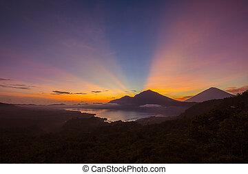 Scenic sunrise and mist at Agung volcano, Kintamani, Bali,...
