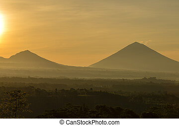 Scenic sunrise and mist at Batur and Agung volcano,...