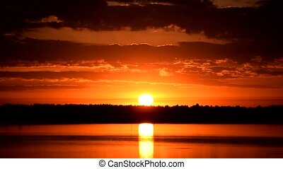 Scenic sunrise over water with beautiful sky