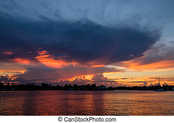 Scenic sunrise with coastline and colorful clouds