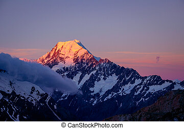 Scenic sunset view of Mt Cook summit with colorful sky, NZ