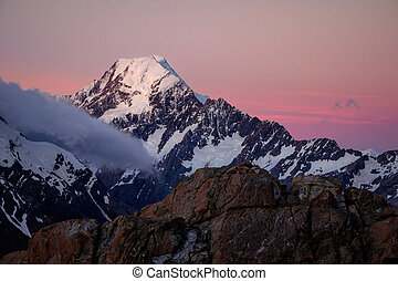 Scenic sunset view of Mt Cook with colorful sky, NZ