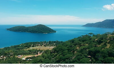 Scenic tropical landscape and blue water and islands of Lake Malawi. Drone shot.