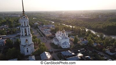 Aerial view of Shuya Orthodox Resurrection cathedral and bell tower on background with Teza River and cityscape, Russia