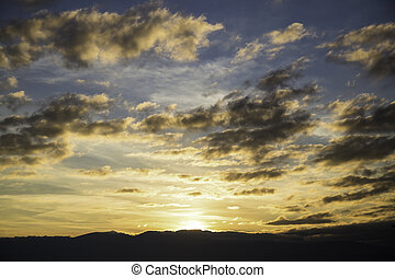 Scenic view of a beautiful sunset over the black silhouettes of the mountains