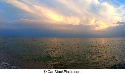 Scenic view of beautiful sunset above the sea. Sun shining...