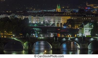 Scenic view of bridges on the Vltava river night timelapse...