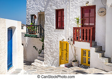 Scenic view of colorful street in traditional Greek cycladic village