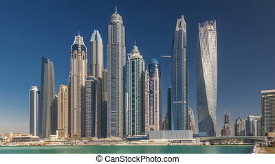 Scenic view of Dubai Marina Skyscrapers with boats timelapse, Skyline, View from sea, United Arab Emirates