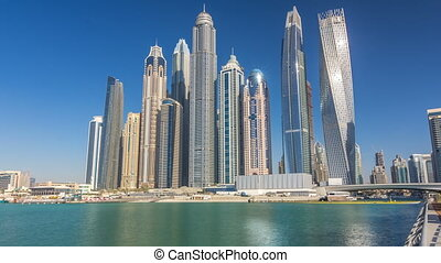 Scenic view of Dubai Marina Skyscrapers with boats...