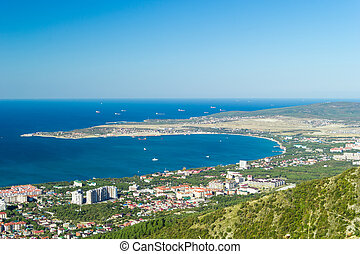 Scenic view of Gelendzhik city district and sea bay. Sunny day. Vacation on resort.