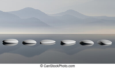 Scenic view of lake with mountain reflections and Zen stones in the water
