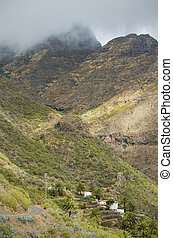 Scenic view of Masca village and mountains on a cloudy day in Tenerife, Spain.