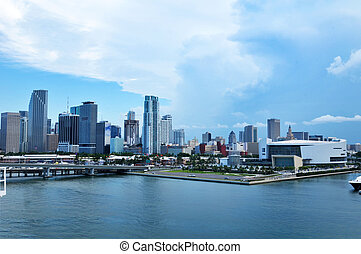 Scenic view of Miami city skyline with boat sailing in...