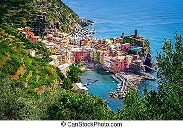 Scenic view of ocean and harbor in colorful village Vernazza, Cinque Terre, Italy