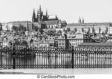 Scenic view of Prague Castle, Czech: Prazsky Hrad, from Vltava River embankment on sunny spring day, Praha, Czech Republic
