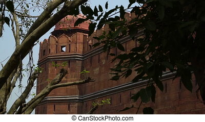 Scenic view of Red Fort through trees. - Red Fort (Lal Qila)...