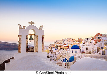 Scenic view of romantic sunset in colorful Santorini village