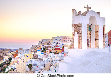 Scenic view of romantic sunset in colorful Santorini village Oia