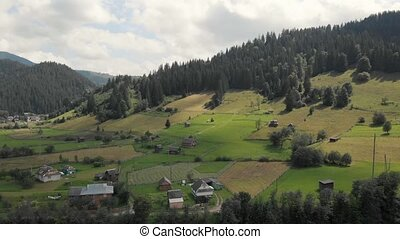 Scenic view of rural area in mountains.