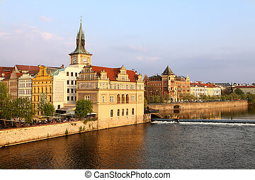 Old Town ancient architecture and Vltava river pier in Prague