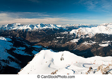 scenic view of snow covered mountains from arosa with valley of chur, switzerland