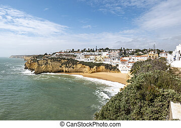 scenic view to romantic fishermen village carvoeiro at the Algarve in Portugal