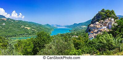 Beautiful Pietraferrazzana village, mountains and Lake of Bomba, Italy.