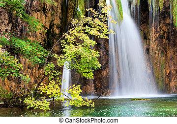 Scenic Waterfall in Autumn